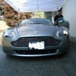 front of grey aston martin