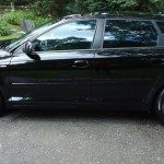 side view of a black audi