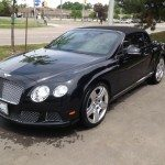 front side view of a black bentley